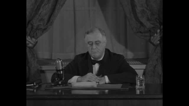vídeos y material grabado en eventos de stock de us pres franklin d roosevelt sitting at desk speaks into microphone regarding nazi domination of europe never before since jamestown and plymouth... - franklin roosevelt