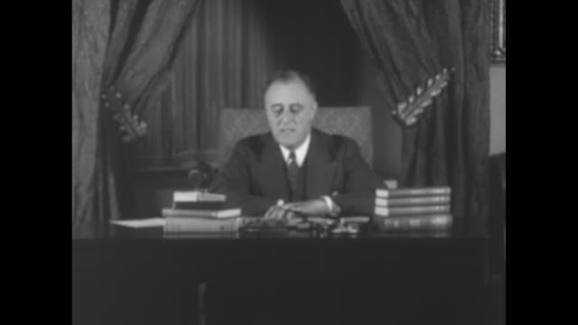 sot pres franklin roosevelt sitting at desk speaking outlining steps to restore banking system during banking holiday allowing federal reserve banks... - new deal stock-videos und b-roll-filmmaterial