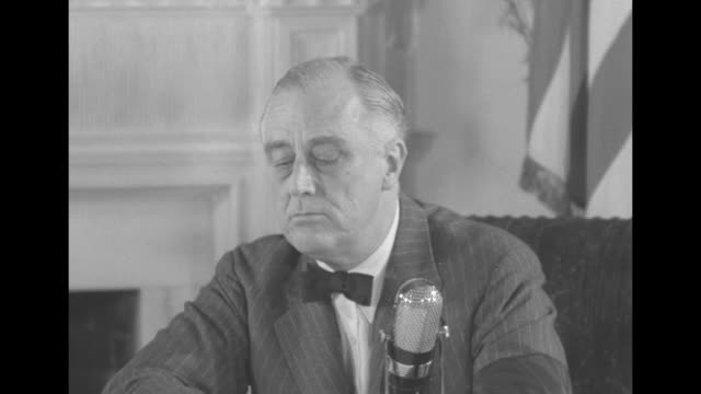 pres. franklin roosevelt sitting at desk speaking / radio operators for nbc sitting at controls with earphones on / roosevelt speaking about going to... - ラジオ放送点の映像素材/bロール