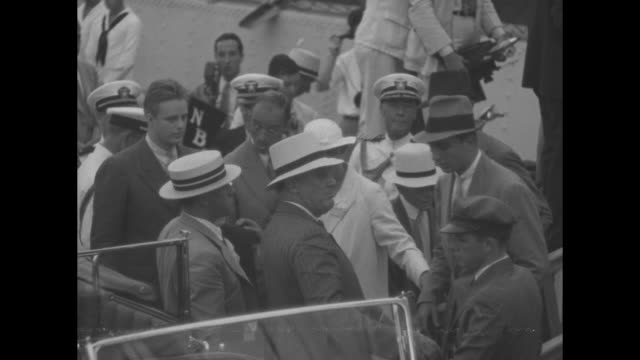 pres franklin roosevelt sitting in back seat of open car shaking hands with man standing beside car crowd surrounding them including sailors standing... - family back lit stock videos & royalty-free footage