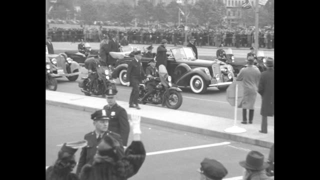 Pres Franklin Roosevelt sitting in back seat of open car with Vice President Elect Henry Wallace First Lady Eleanor Roosevelt sitting on left in seat...