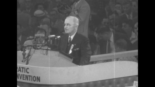 US Pres Harry Truman and convention chairman/House Speaker Sam Rayburn walk with clasped hands to podium at the Democratic National Convention as VO...