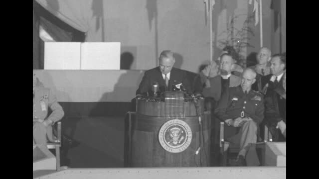 pres. harry truman, standing at podium on stage with officers and officials in gillis field house, giving speech regarding war in korea / overhead... - harry truman stock videos & royalty-free footage