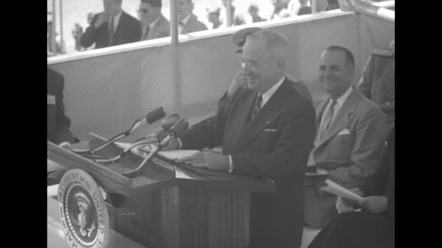 pres harry truman standing at podium speaking during keel laying ceremony for the uss nautilus / indistinct shot / truman speaking - dynamics stock videos and b-roll footage
