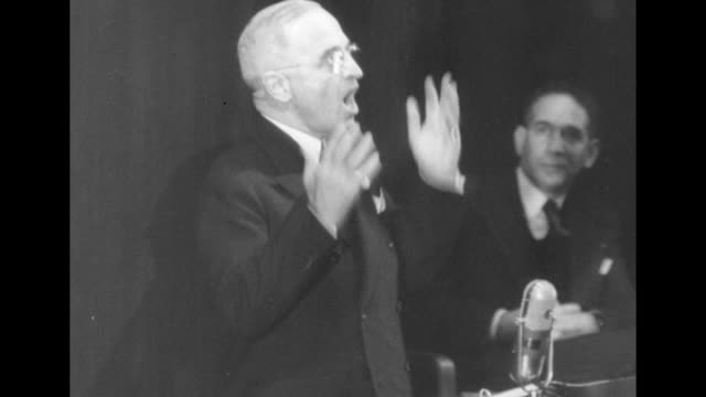 us pres harry truman standing at podium speaking to general assembly in administration building of world's fair in flushing meadows / overhead shot... - 1946 stock videos and b-roll footage
