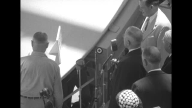 pres harry truman walking away from keel of the uss nautilus during laying ceremony / truman initials keel / two shots of truman making formal... - dynamics stock videos and b-roll footage