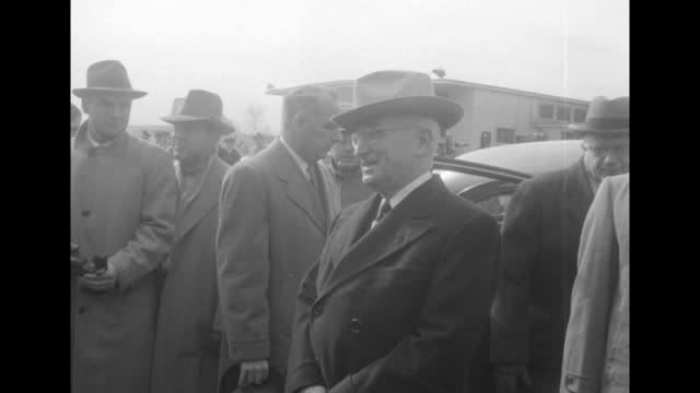 pres. harry truman, wearing stetson hat, getting out of car and being met by officials / truman talking to reporter / truman stands on tarmac next to... - harry truman stock videos & royalty-free footage