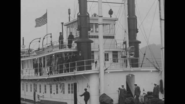 pres herbert hoover and wife lou stand on upper deck of us greenbrier / the paddlewheeler steams on river with hoovers waving / turning wheel of ship... - herbert hoover us president stock videos & royalty-free footage