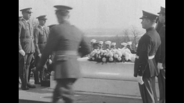 pres herbert hoover backs away from tomb of the unknowns after laying wreath on it soldiers standing in formation on either side of tomb first lady... - armistice day stock videos and b-roll footage