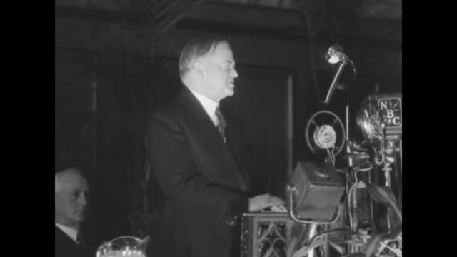 pres herbert hoover stands in front of microphones delivers speech at the governors conference flashbulbs occasionally pop he refers to notes posted... - herbert hoover us president stock videos & royalty-free footage