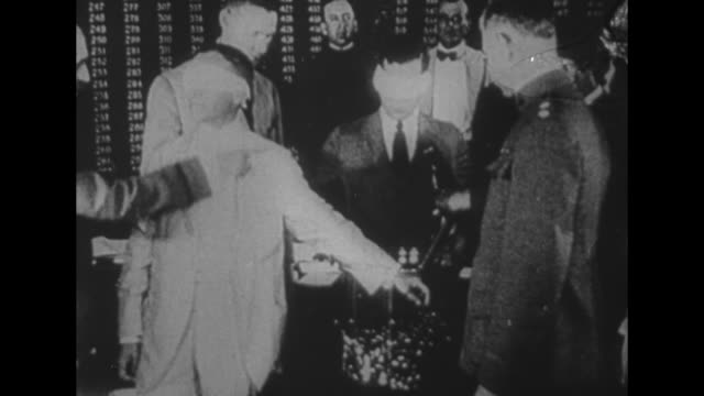 stockvideo's en b-roll-footage met pres woodrow wilson sits at desk writes on document / cu declaration of war against germany dated 4/6/1917 with wilson's signature along with those... - woodrow wilson