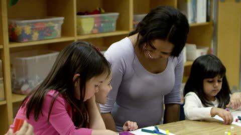preschool art time - mixed age range stock videos & royalty-free footage