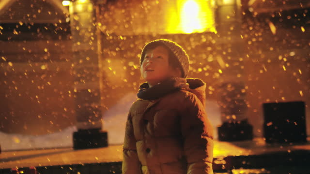 preschool boy playing in the snow at night. - joy stock videos & royalty-free footage