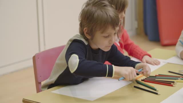 4k: preschool children coloring and sketching. - pencil sharpener stock videos & royalty-free footage