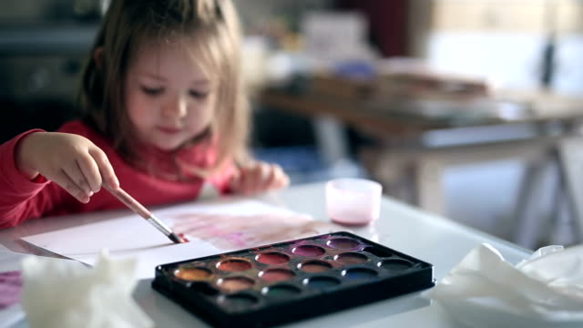 preschool girl painting picture with acrylic paints - one girl only stock videos & royalty-free footage