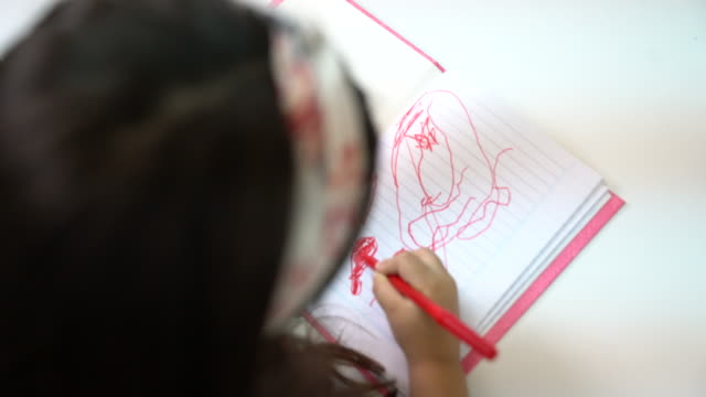 preschool girl scribbling in book at kindergarten - scribble stock videos & royalty-free footage