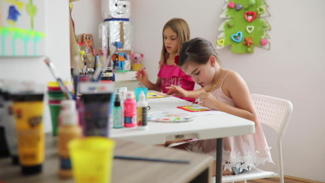 preschool girls painting with water colors in classroom - art and craft stock videos & royalty-free footage