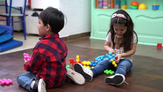 preschool kids playing with toys at kindergarten - floor length stock videos & royalty-free footage