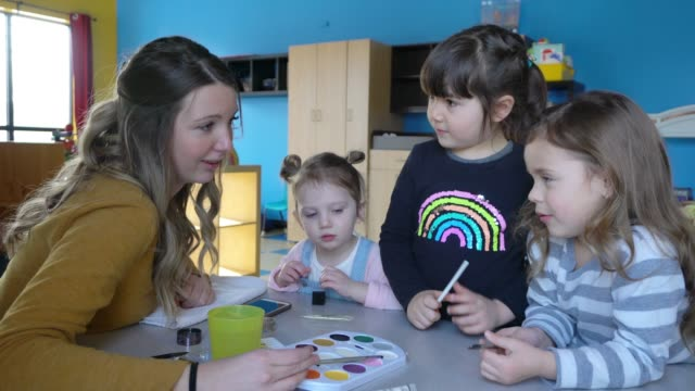 vídeos de stock e filmes b-roll de preschool student paper craft little heroes learning - edifício de infantário
