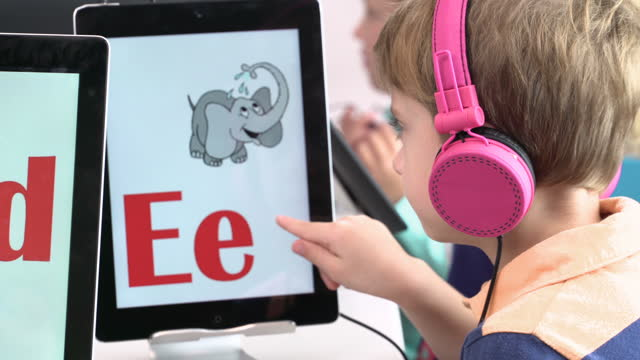 pre-school students learning alphabet on digital tablet - alphabet stock videos & royalty-free footage