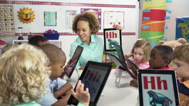 pre-school students learning alphabet on digital tablet - preschool student stock videos and b-roll footage