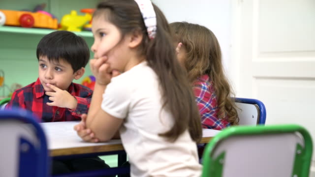 preschool students sitting at desk in classroom - ethnicity stock videos & royalty-free footage