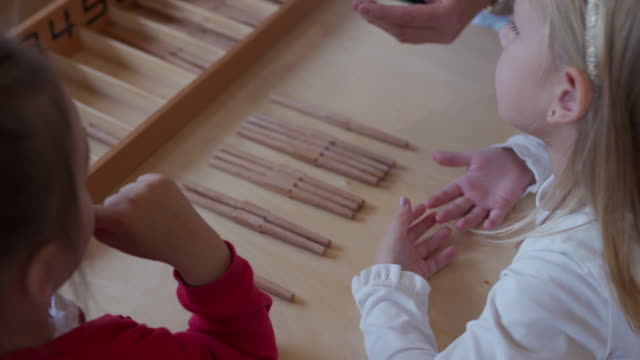 preschool teacher playing with girls in preschool classroom - preschool child stock videos & royalty-free footage