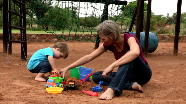 pre-school toddler and mother playing with toys in a sandpit - 2 kid in a sandbox stock videos and b-roll footage
