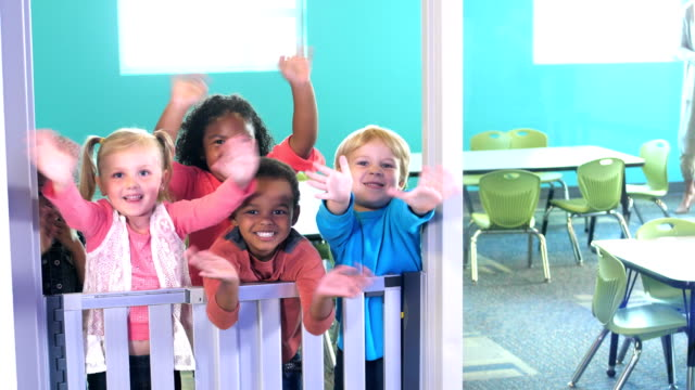preschoolers in class run up to doorway, waving - nursery school child stock videos & royalty-free footage