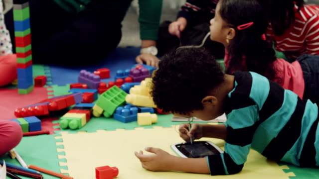 preschoolers playing with blocks at a daycare center - preschool child stock videos & royalty-free footage