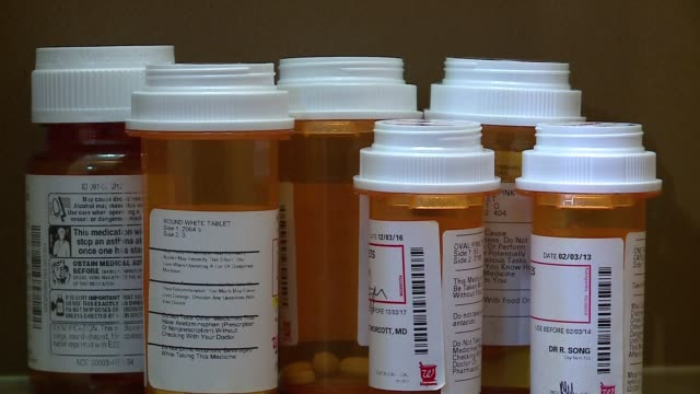 prescription pill bottles in a medicine cabinet in chicago on march 15, 2017. - prescription medicine stock-videos und b-roll-filmmaterial