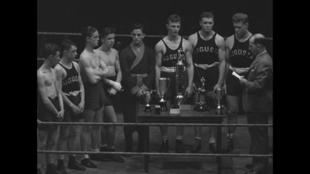 presentation of awards by george w roberts, chair aau virginia state boxing committee; sidney trott, president of va sportsman's assn; winners earl... - tucker stock videos & royalty-free footage