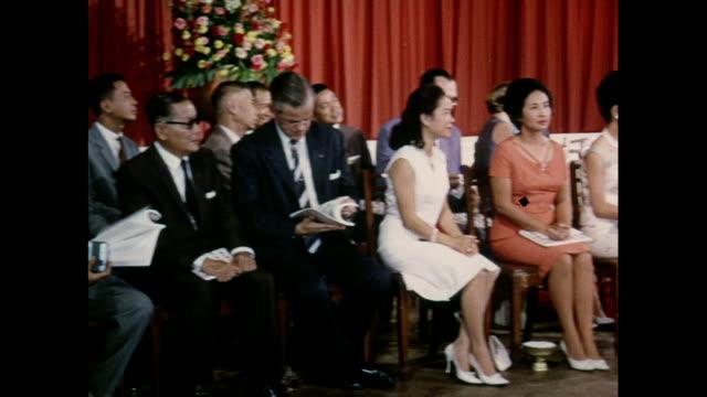 presentation of awards by queen sirikit in front of an audience in thailand - heder bildbanksvideor och videomaterial från bakom kulisserna