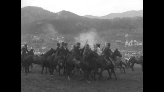 stockvideo's en b-roll-footage met presentation of indians and soldiers fighting on horseback gunfire and smoke homes and hills in bg / indians dancing / indians miners and others in... - amerikaans indiaanse etniciteit