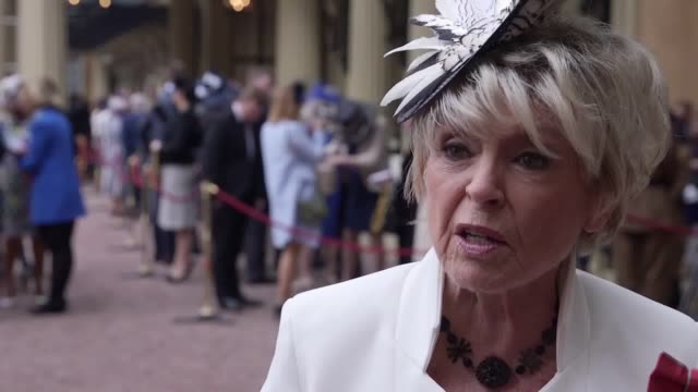 presenter and singer, gloria hunniford, gives an interview at buckingham palace after receiving an obe from the queen, for services to charity. - グロリア ハニフォード点の映像素材/bロール