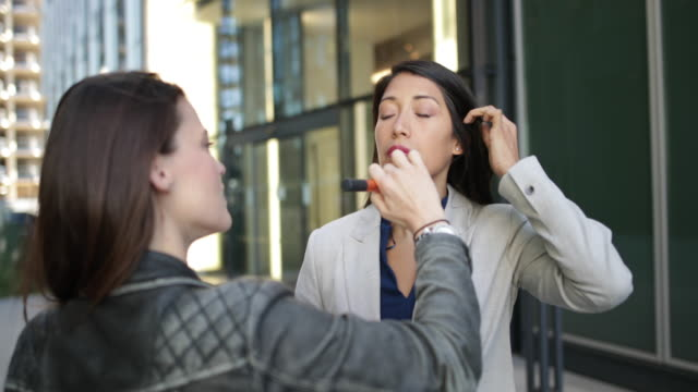TV presenter having make-up applied on location