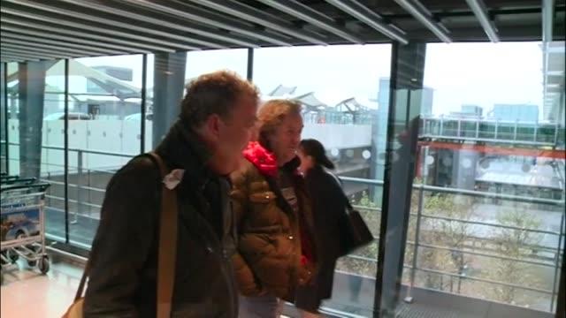 presenter jeremy clarkson, presenter of bbc programme top gear walks through heathrow to check-in for flight - ジェレミー クラークソン点の映像素材/bロール