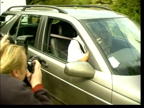 stockvideo's en b-roll-footage met presenter ulrika jonsson along past driving car - ulrika jonsson
