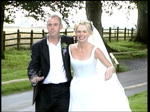 ext ms tv presenter zoe ball and dj norman cook towards for press photocall at their wedding cf = d0616348 or d0616347 000907 to 000933 fx order ref... - zoe ball stock videos and b-roll footage