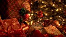 presents by christmas tree