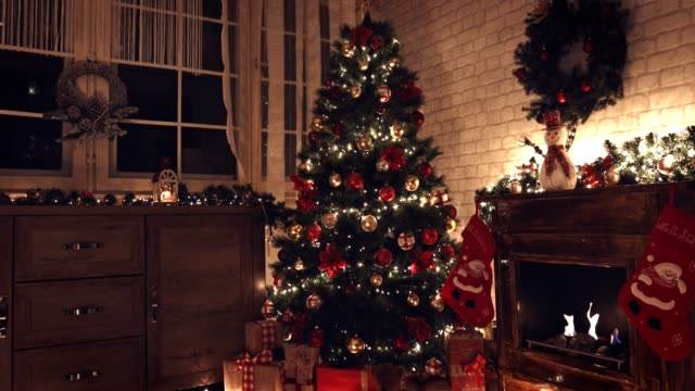 presents under the christmas tree - christmas tree stock videos & royalty-free footage