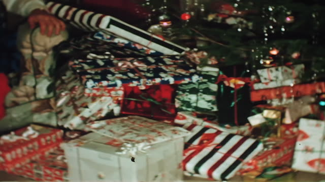 presents underneath a 1950's christmas tree. - 1950 stock videos & royalty-free footage