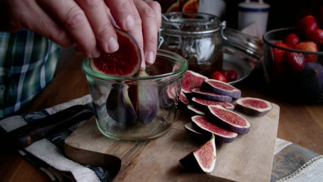 preserving figs with honey in jars - canning stock videos & royalty-free footage
