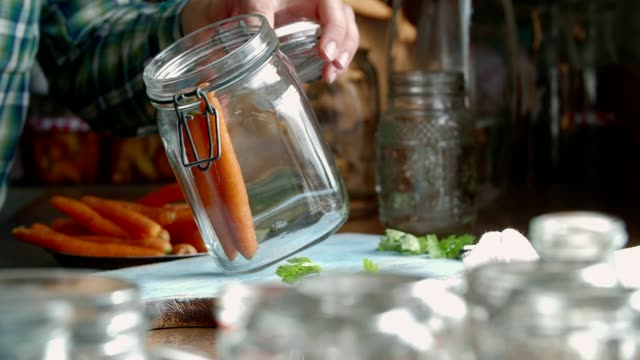 preserving organic carrots in jars - preserved in oil stock videos and b-roll footage