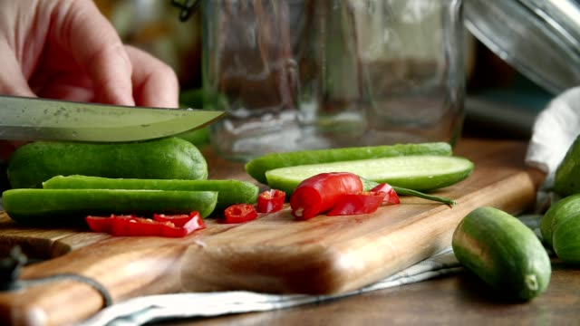 preserving organic cucumbers in jars - pickled stock videos and b-roll footage