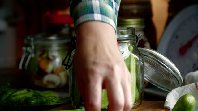preserving organic cucumbers in jars - preserved in oil stock videos and b-roll footage