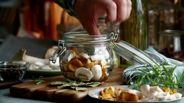 preserving organic mushrooms in jars - chanterelle stock videos & royalty-free footage