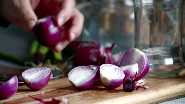 preserving organic red onions and red spring onions in jars - shallot stock videos & royalty-free footage