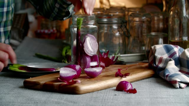 preserving organic red onions and red spring onions in jars - preserved in oil stock videos and b-roll footage