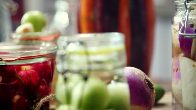 preserving organic vegetables in jars - fermenting stock videos and b-roll footage